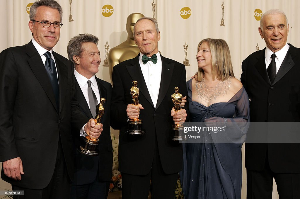 Tom Rosenberg, Clint Eastwood and Albert S. Ruddy, winners Best Picture for 'Million Dollar Baby,' with presenters Dustin Hoffman (2nd from left) and Barbra Streisand