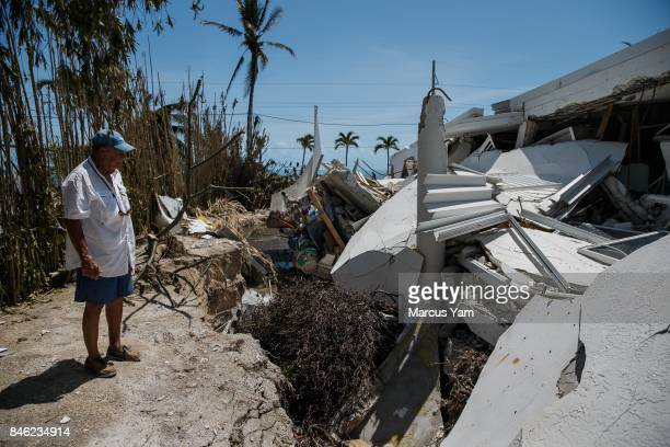Tom Ross inspects the damage to his 3story condominium building in the aftermath of Hurricane Irma in Islamorada Florida Keys on Sept 12 2017