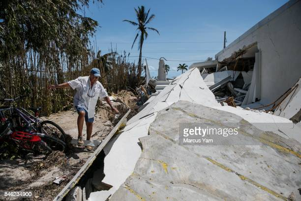 Tom Ross walks delicately as he inspects the damage to his condominium building in the aftermath of Hurricane Irma in Islamorada Florida Keys on Sept...