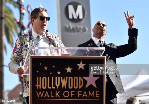 Tom Rothman Chairman of Sony Entertainment's Motion Picture Group and actor Dwayne Johnson attend a ceremony honoring Dwayne Johnson with the 2624th...