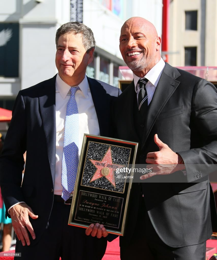 Tom Rothman, Chairman of Sony Entertainment's Motion Picture Group and actor Dwayne Johnson attend a ceremony honoring Dwayne Johnson with the 2,624th star on the Hollywood Walk of Fame on December 13, 2017 in Hollywood, California.