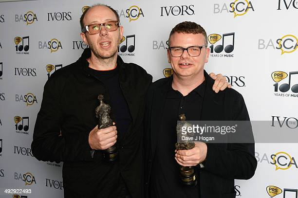 Tom Rowlands and Ed Simons of The Chemical Brothers pose with their Outstanding Song Collection Award in the winners room at The Ivor Novello Awards...