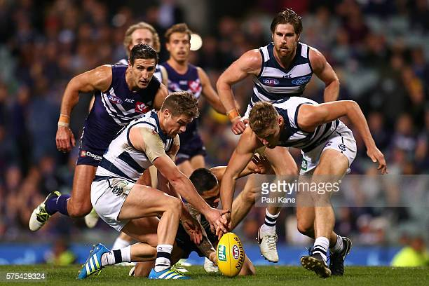 Tom Ruggles and Jake Kolodjashnij of the Cats contest for the ball against Michael Walters of the Dockers during the round 17 AFL match between the...