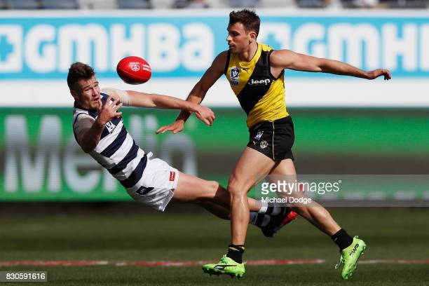 Tom Ruggles of Geelong and Sam Lloyd of Richmond compete for the ball during the round 16 VFL match between Geelong and Richmond at Simonds Stadium...
