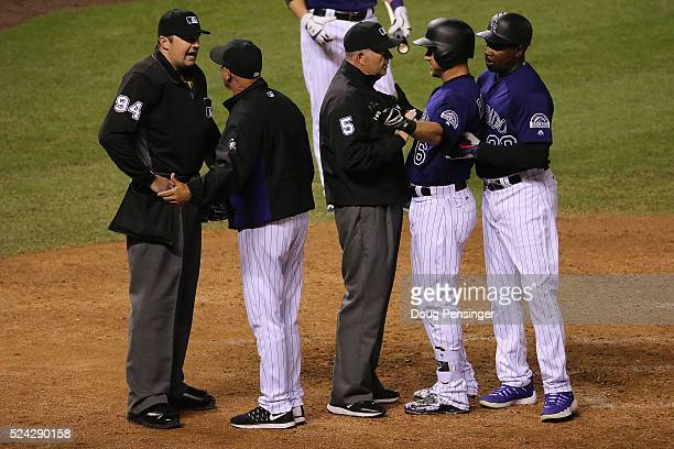 Tom Runnells of the Colorado Rockies argues with homeplate umpire Lance Barrett after he ejected Ryan Raburn of the Colorado Rockies for arguing a...