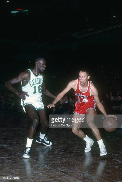 Tom Sanders of the Boston Celtics guards Lenny Wilkens of the St Louis Hawks during an NBA basketball game circa 1965 at the Boston Garden in Boston...