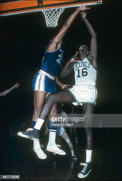 Tom Sanders of the Boston Celtics shoots over Elgin Baylor of the Los Angeles Lakers during an NBA basketball game circa 1965 at the Boston Garden in...