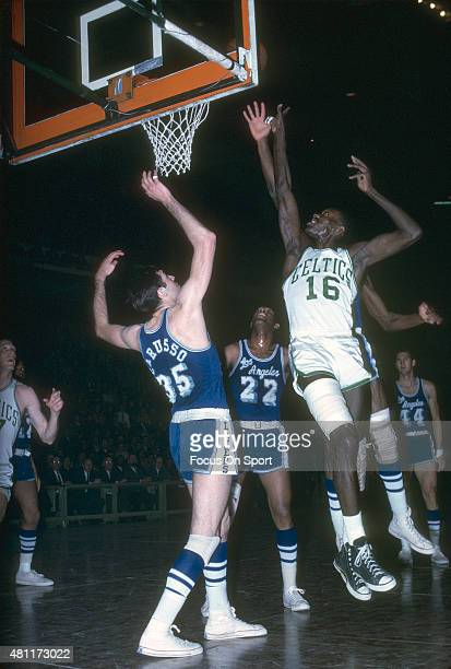 Tom Sanders of the Boston Celtics shoots over Rudy LaRusso and Elgin Baylor of the Los Angeles Lakers during an NBA basketball game circa 1965 at the...