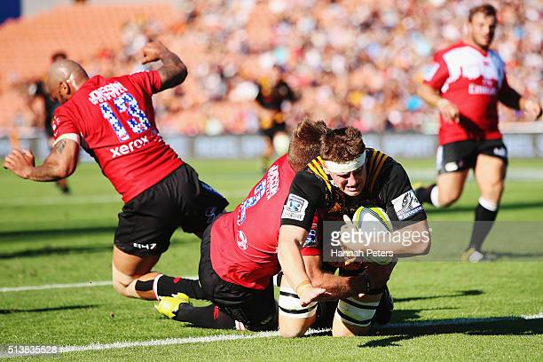 Tom Sanders of the Chiefs dives over to score a try during the round two Super Rugby match between the Chiefs and the Lions at FMG Stadium on March 5...