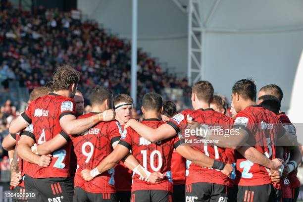 Tom Sanders of the Crusaders and his team mates huddle prior to the round 9 Super Rugby Aotearoa match between the Crusaders and the Highlanders at...