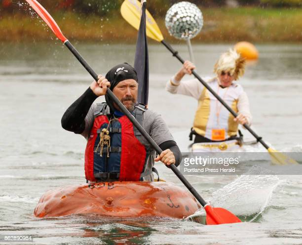 Tom Sandstrom of Easton Mass paddles with Alice Bean of Brunswick behind him during the paddleboat division of the Pumpkin Regatta part of the...