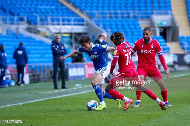 Tom Sang of Cardiff City FC and Alex Mighten of Nottingham Forest during the Sky Bet Championship match between Cardiff City and Nottingham Forest at...
