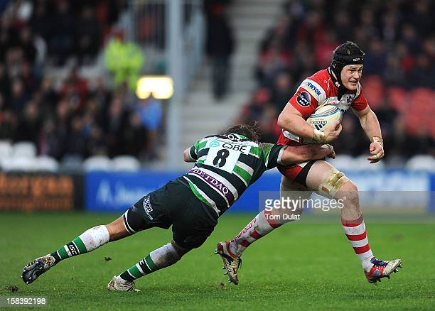 Tom Savage of Gloucester is tackled by Alex Gray of London Irish during the Amlin Challenge Cup match between Gloucester and London Irish at...
