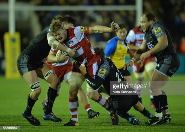 Tom Savage of Gloucester Rugby tries to break through the Newcastle Falcons' defence during the Aviva Premiership match between Newcastle Falcons and...