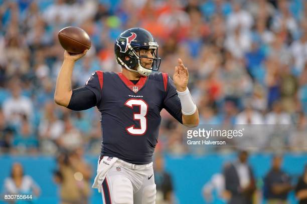 Tom Savage of the Houston Texans against the Carolina Panthers during their game at Bank of America Stadium on August 9 2017 in Charlotte North...