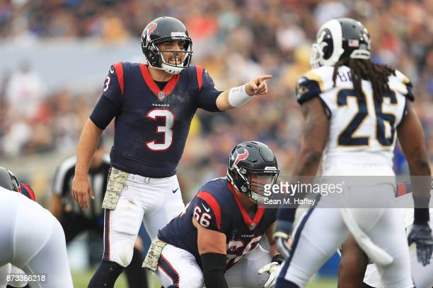 Tom Savage of the Houston Texans communicates to his teammates during the game against the Los Angeles Rams at the Los Angeles Memorial Coliseum on...
