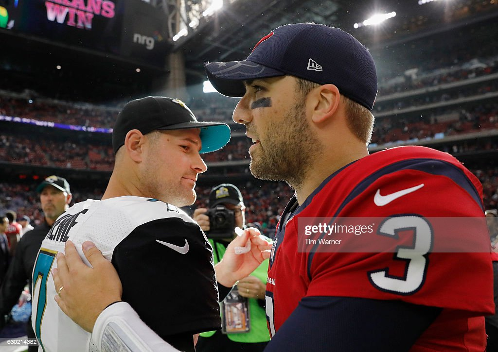 Tom Savage #3 of the Houston Texans greets Chad Henne #7 of the Jacksonville Jaguars after the game at NRG Stadium on December 18, 2016 in Houston, Texas.