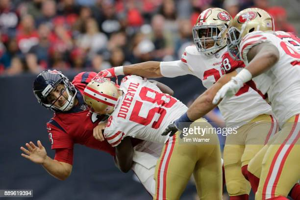 Tom Savage of the Houston Texans is hit by Elvis Dumervil of the San Francisco 49ers in the second quarter at NRG Stadium on December 10 2017 in...