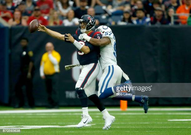 Tom Savage of the Houston Texans is pressured by Jonathan Bostic of the Indianapolis Colts in the first quarter at NRG Stadium on November 5 2017 in...