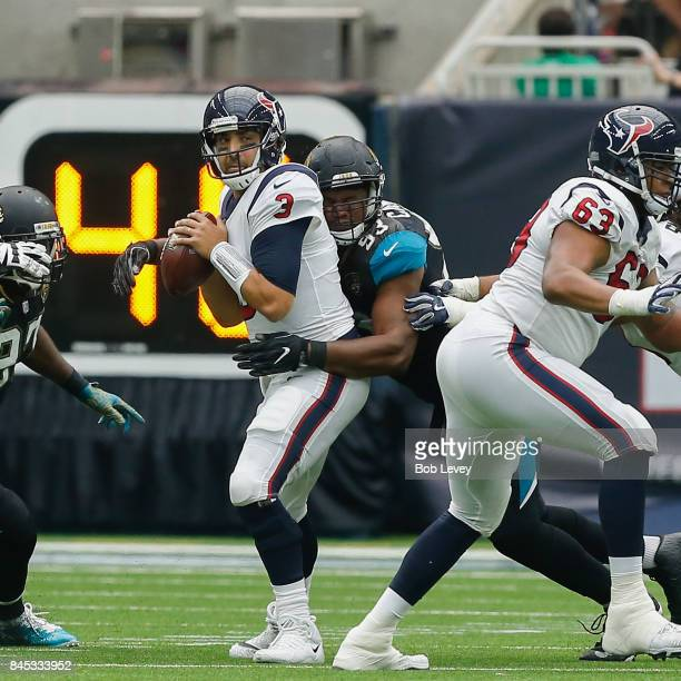 Tom Savage of the Houston Texans is sacked by Calais Campbell of the Jacksonville Jaguars in the second quarter at NRG Stadium on September 10 2017...