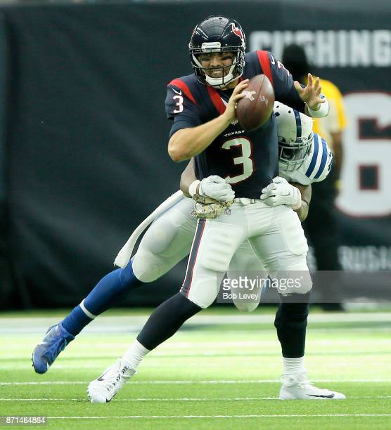 Tom Savage of the Houston Texans is sacked by Jonathan Bostic of the Indianapolis Colts at NRG Stadium on November 5 2017 in Houston Texas...