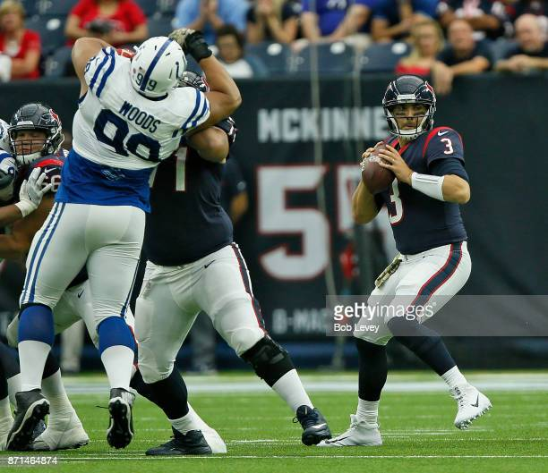 Tom Savage of the Houston Texans looks for a receiver as Xavier Su'a-Filo blocks Al Woods of the Indianapolis Colts at NRG Stadium on November 5,...