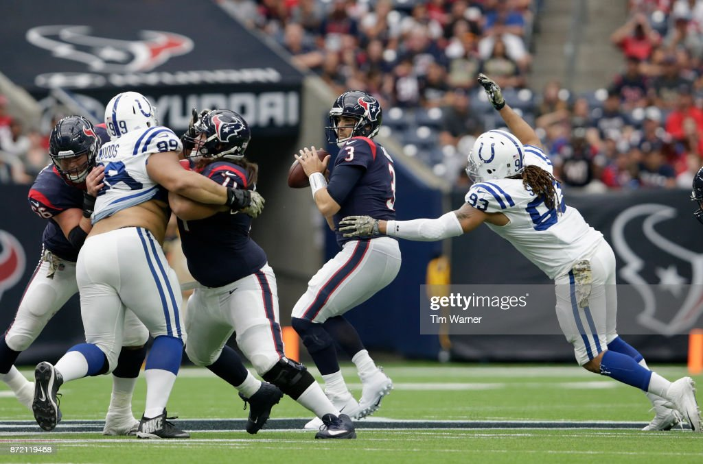 Tom Savage #3 of the Houston Texans looks to pass under pressure by Jabaal Sheard #93 of the Indianapolis Colts in the third quarter at NRG Stadium on November 5, 2017 in Houston, Texas.