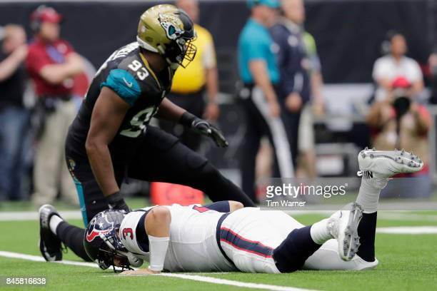 Tom Savage of the Houston Texans reacts to being hit by Calais Campbell of the Jacksonville Jaguars in the first quarter at NRG Stadium on September...
