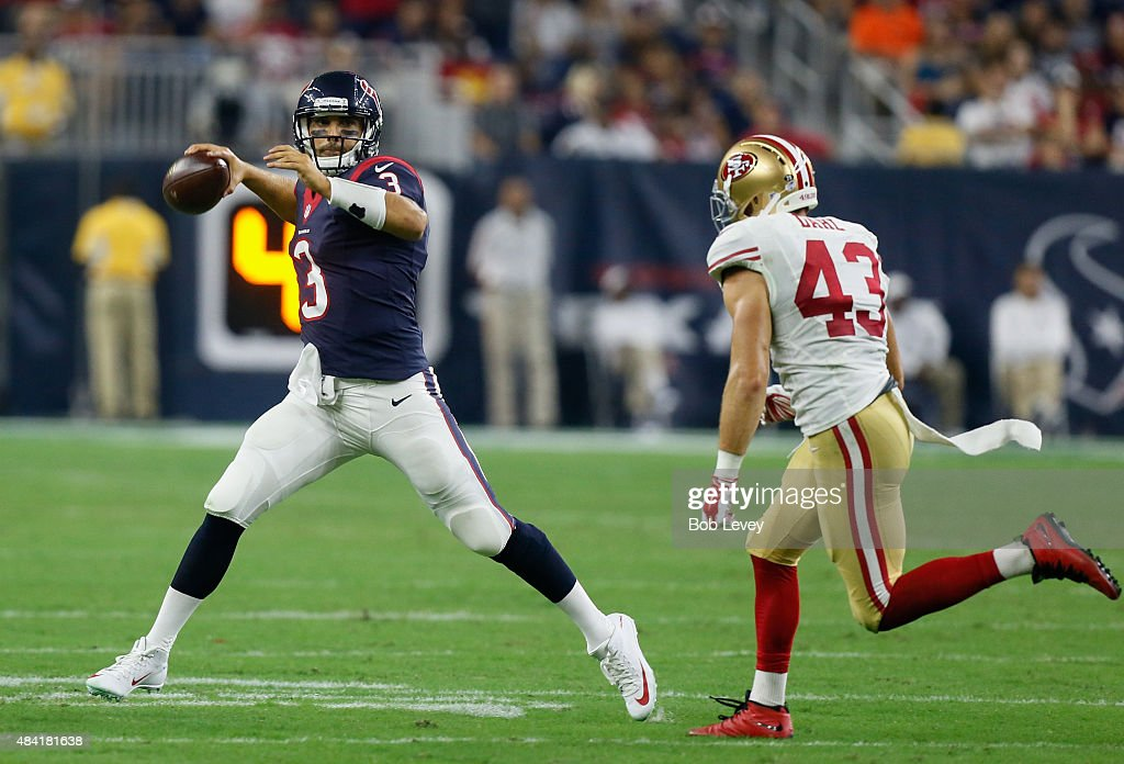 Tom Savage #3 of the Houston Texans rolls out looking for a receiver as he is pursued by Craig Dahl #43 of the San Francisco 49ers in the fourth quarter at Reliant Arena at Reliant Park on August 15, 2015 in Houston, Texas.