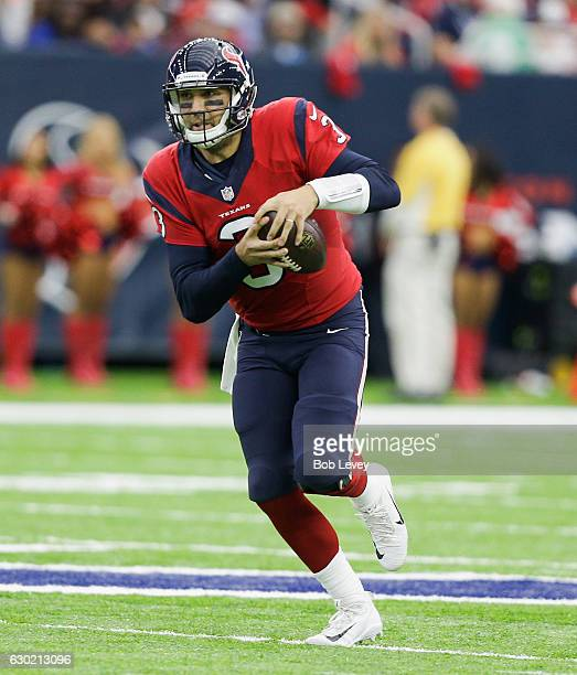 Tom Savage of the Houston Texans runs with the ball in the fourth quarter against the Jacksonville Jaguars at NRG Stadium on December 18 2016 in...