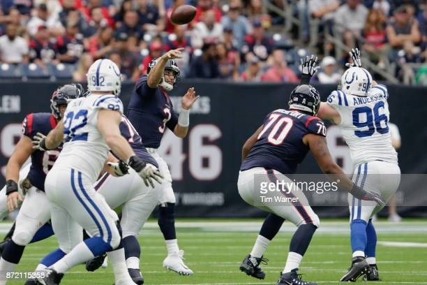Tom Savage of the Houston Texans throws a pass under pressure by Henry Anderson of the Indianapolis Colts in the first quarter at NRG Stadium on...