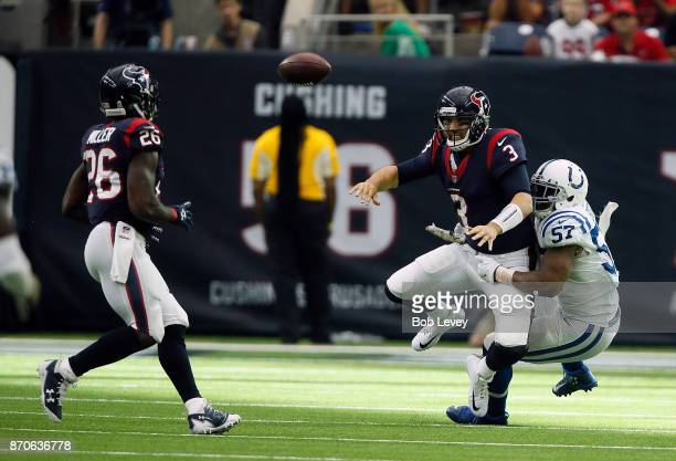 Tom Savage of the Houston Texans throws a shuttle pass to Lamar Miller as he is tackled by Jonathan Bostic of the Indianapolis Colts at NRG Stadium...