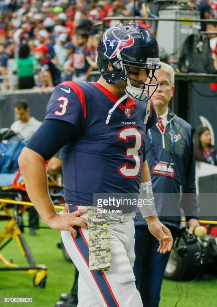 Tom Savage of the Houston Texans walks off the field after losing to the Indianapolis Colts at NRG Stadium on November 5 2017 in Houston Texas