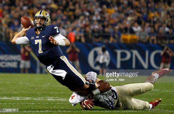 Tom Savage of the Pittsburgh Panthers throws the ball away in the first half against DeMarcus Walker of the Florida State Seminoles during the game...