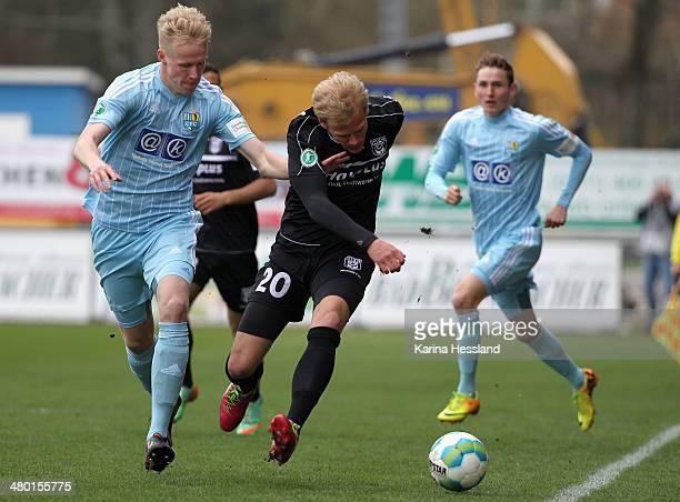 Tom Scheffel of Chemnitz challenges Soeren Bertram of Halle during the third Liga match between Chemnitzer FC and Hallescher FC at Stadion an der...