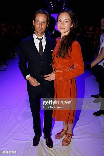 Tom Schilling and Annie Mosebach attend the Esther Perbandt show during the MercedesBenz Fashion Week Berlin Spring/Summer 2016 at Brandenburg Gate...