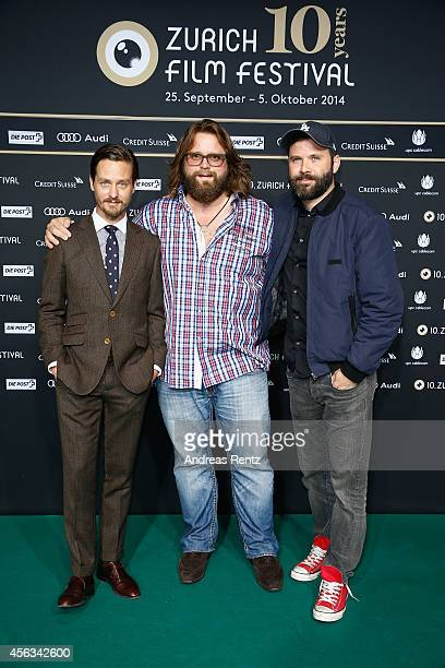 Tom Schilling Antoine Monot Jr and director Baran bo Odar attend the 'Who am I' Green Carpet Arrivals during Day 5 of Zurich Film Festival 2014 on...