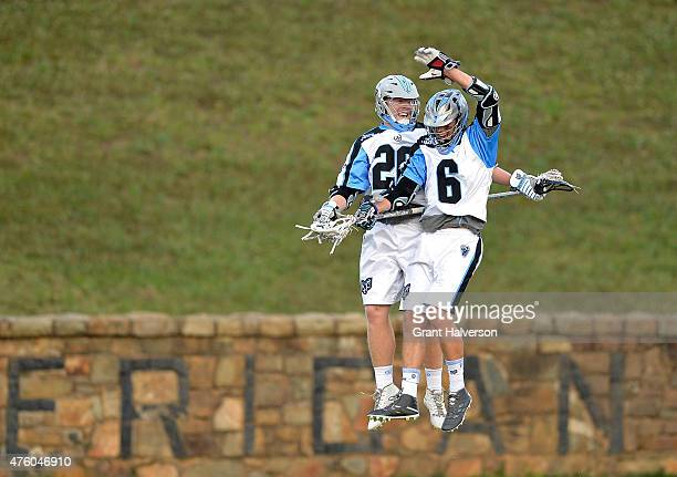 Tom Schreiber celebrates with teammate Steele Stanwick of the Ohio Machine after scoring a goal against the Charlotte Hounds during their game at...