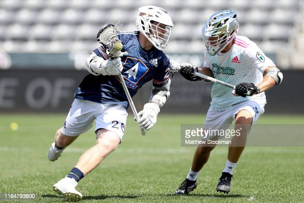 Tom Schreiber of the Archers LC brings the ball out from behind the net against Will Haus of the Chrome LC in the second quarter at Dick's Sporting...