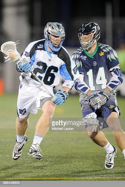 Tom Schreiber of the Ohio Machine runs with the ball with pressure from Drew Westervelt of the Chesapeake Bayhawks during a MLL lacrosse game on May...
