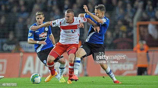 Tom Schuetz and Sebastian Schuppan of Bielefeld tackle Simon Brandstetter of Erfurt during the Third League match between Arminia Bielefeld and RW...