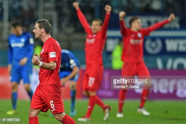 Tom Schuetz Konstantin Kerschbaumer and Brian Behrendt of Bielefeld celebrate after winning the Second Bundesliga match between VfL Bochum 1848 and...
