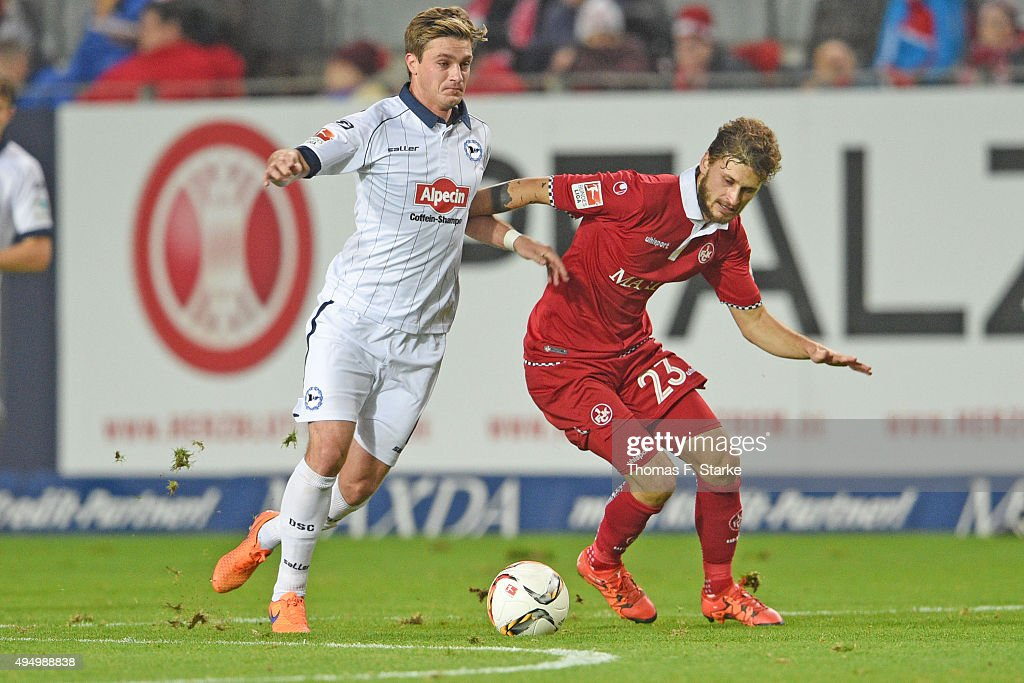 Tom Schuetz (L) of Bielefeld and Mateusz Klich of Kaiserslautern fight for the ball during the Second Bundesliga match between 1. FC Kaiserslautern and Arminia Bielefeld at Fritz-Walter-Stadion on October 30, 2015 in Kaiserslautern, Germany.