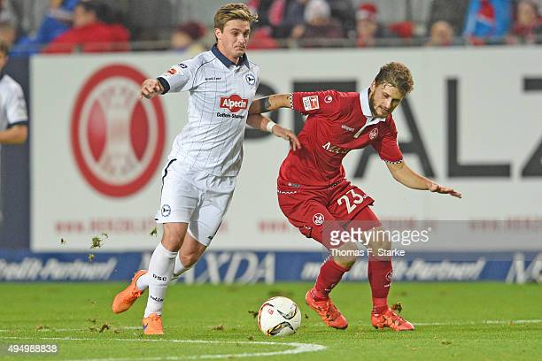 Tom Schuetz of Bielefeld and Mateusz Klich of Kaiserslautern fight for the ball during the Second Bundesliga match between 1 FC Kaiserslautern and...