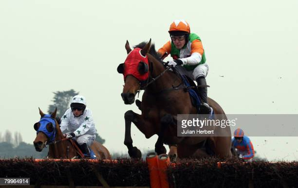 Tom Scudamore and Lough Derg clear an early flight before landing The totesportcom National Spirit Hurdle Race run at Fontwell Racecourse on February...