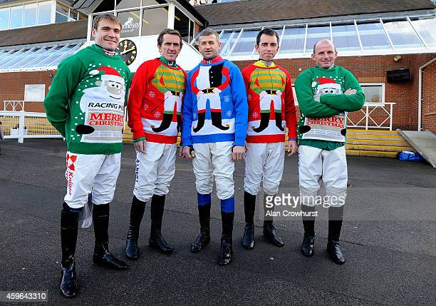 R Tom Scudamore AP McCoy Andrew Thornton Leighton Aspell and Paul Moloney model christmas jumpers that are on sale at the track at Newbury racecourse...
