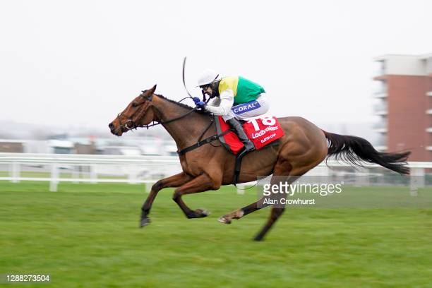 Tom Scudamore riding Cloth Cap clear the last to win The Ladbrokes Trophy Chase at Newbury Racecourse on November 28, 2020 in Newbury, England....