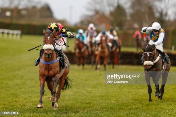 Tom Scudamore riding Colt Lightning clear the last to win The myracingcom For Free Bets And Tips Novices' Handicap Hurdle at Hereford racecourse on...