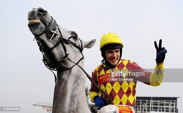 Tom Scudamore riding Dynaste win The Ryanair Steeple Chase on St Patrick's Thursday during the Cheltenham Festival at Cheltenham racecourse on March...