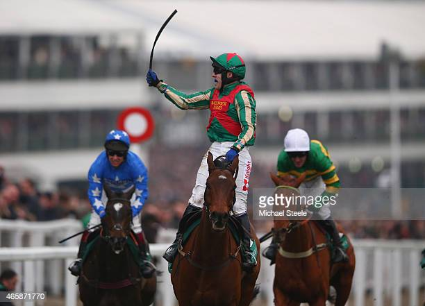 Tom Scudamore riding Moon Racer celebrates winning the Weatherby's Champion Bumper Open Natuonal Hunt Flat Race during day two of the Cheltenham...